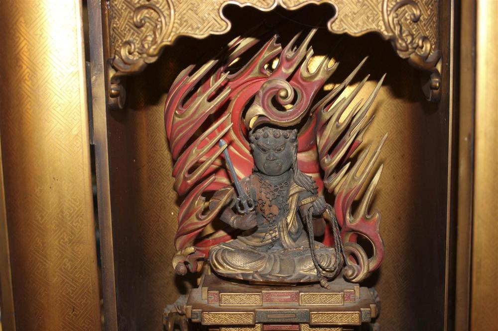 FINE JAPANESE LACQUER BUTSUDAN Doors open to reveal the Buddhist deity Achala Vidyaraja (Fudo Myoo) against a flame mandala, seated...