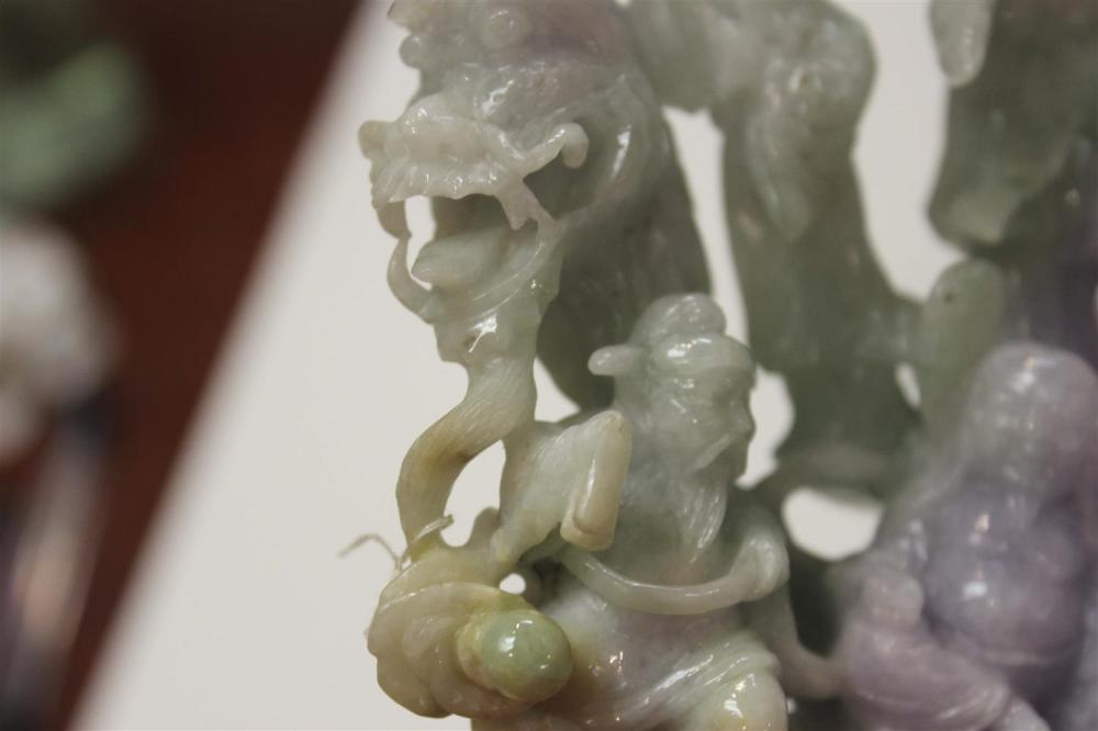 CHINESE LAVENDER AND CELADON JADE OPENWORK-CARVED FIGURE GROUP Nine deities with a gourd. Height 6