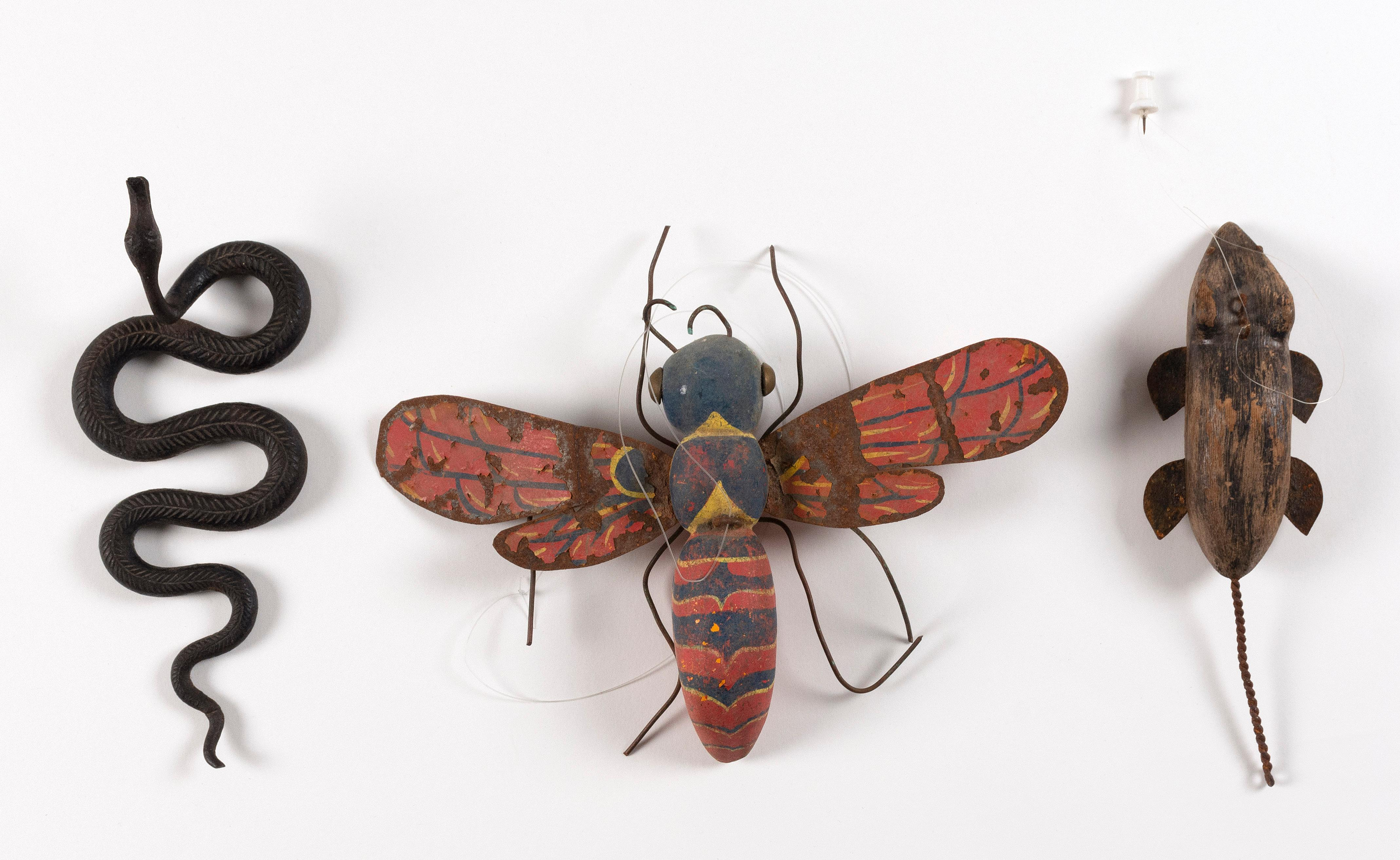 """THREE ANIMAL FIGURES 1) Flying wasp with carved and painted wooden body and paint-decorated tin wings. Length 6"""". 2) Metal slitherin..."""