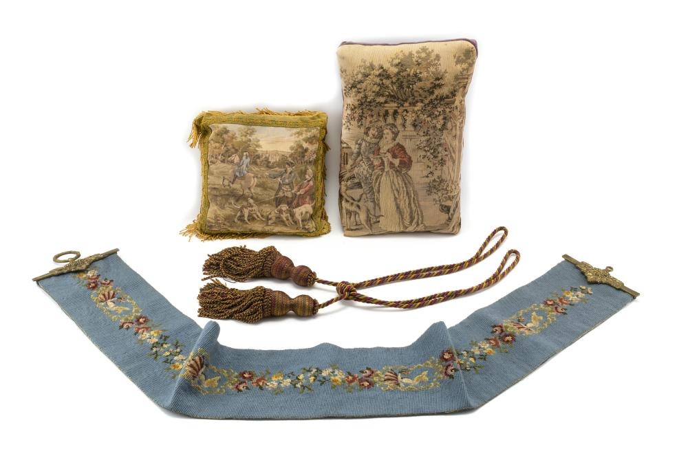FOUR ASSORTED TEXTILES 1) Needlework bell pull with repeating decoration of flowers and a woman in a bonnet. Brass mounts. Length 58...
