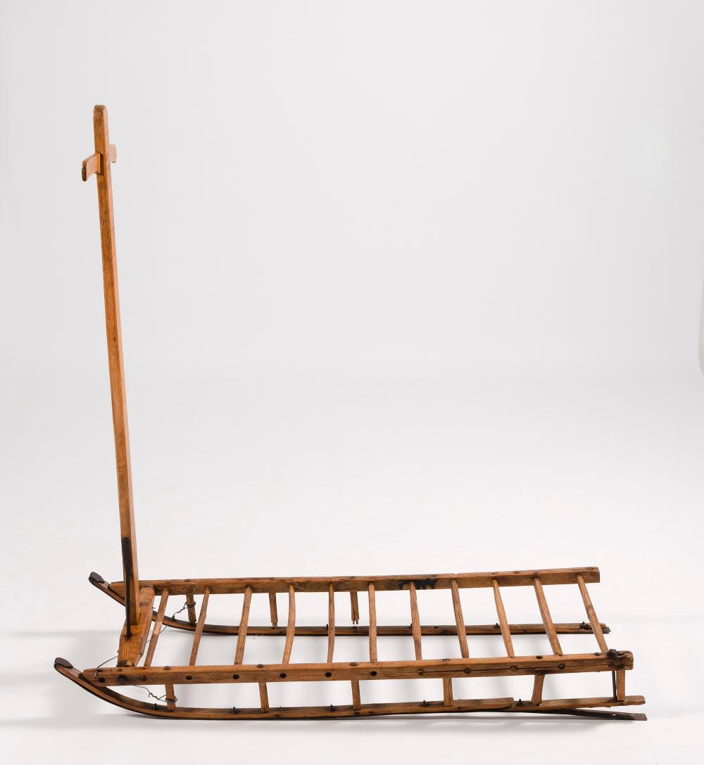 ANTIQUE WOOD AND WROUGHT IRON SLED Unmarked. Length 49