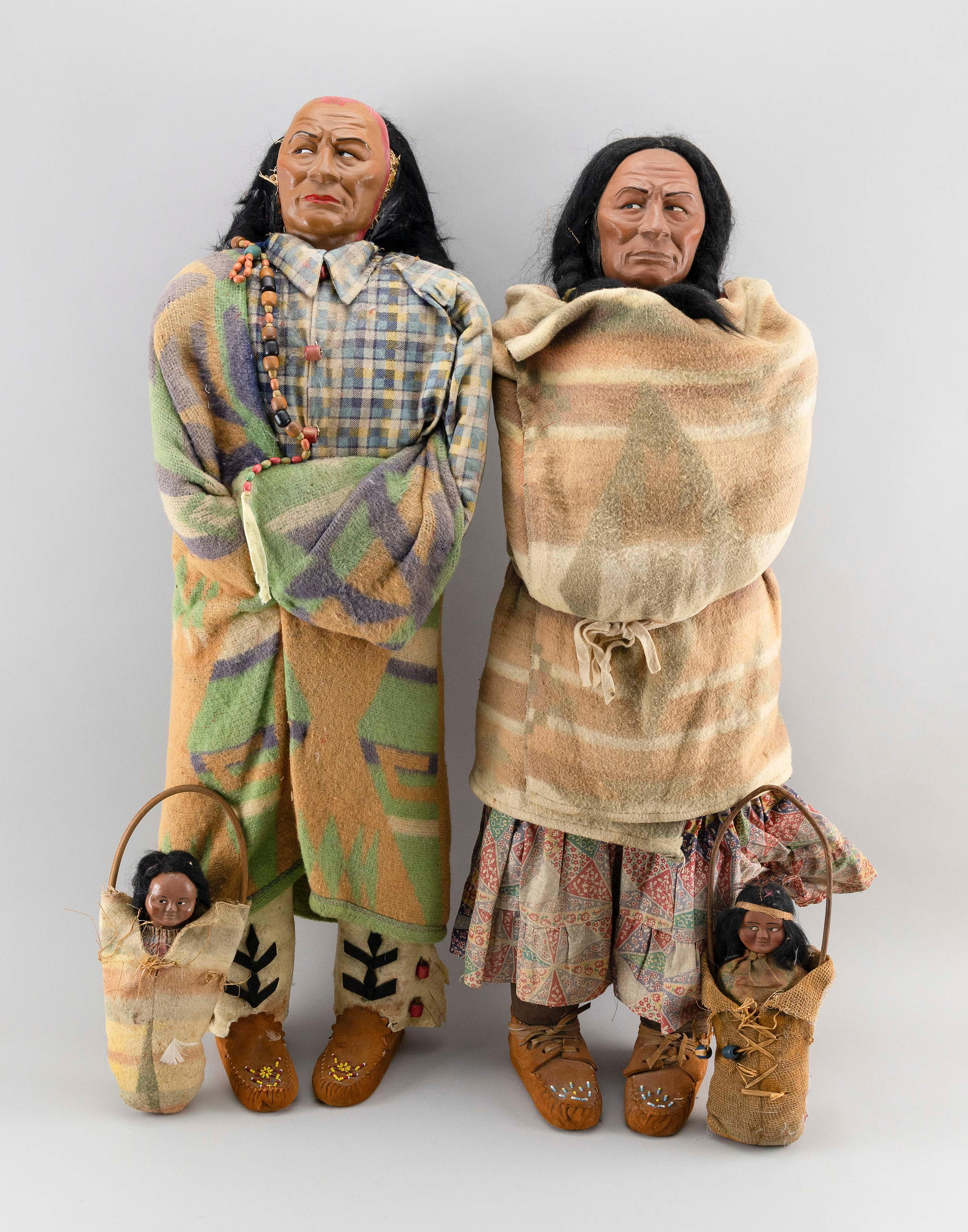 """FOUR SKOOKUM INDIAN DOLLS Two chiefs, heights 33.5"""", and two babies, height 9""""."""