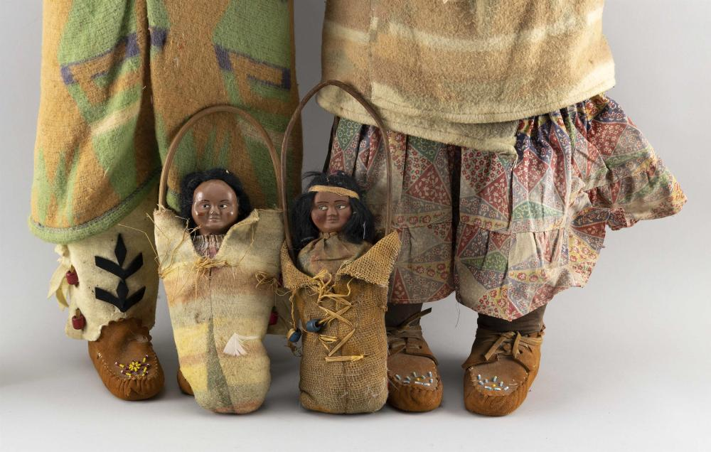 FOUR SKOOKUM INDIAN DOLLS Two chiefs, heights 33.5