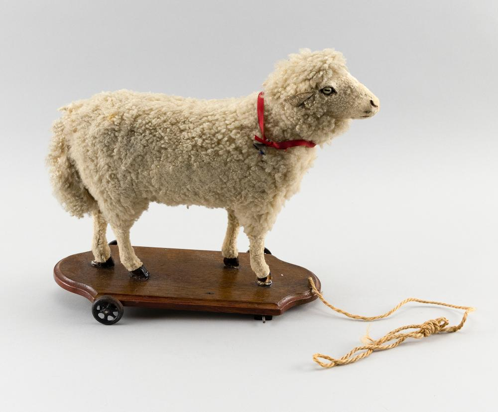 SHEEP PULL TOY Composition sheep on a wooden base. Length 14