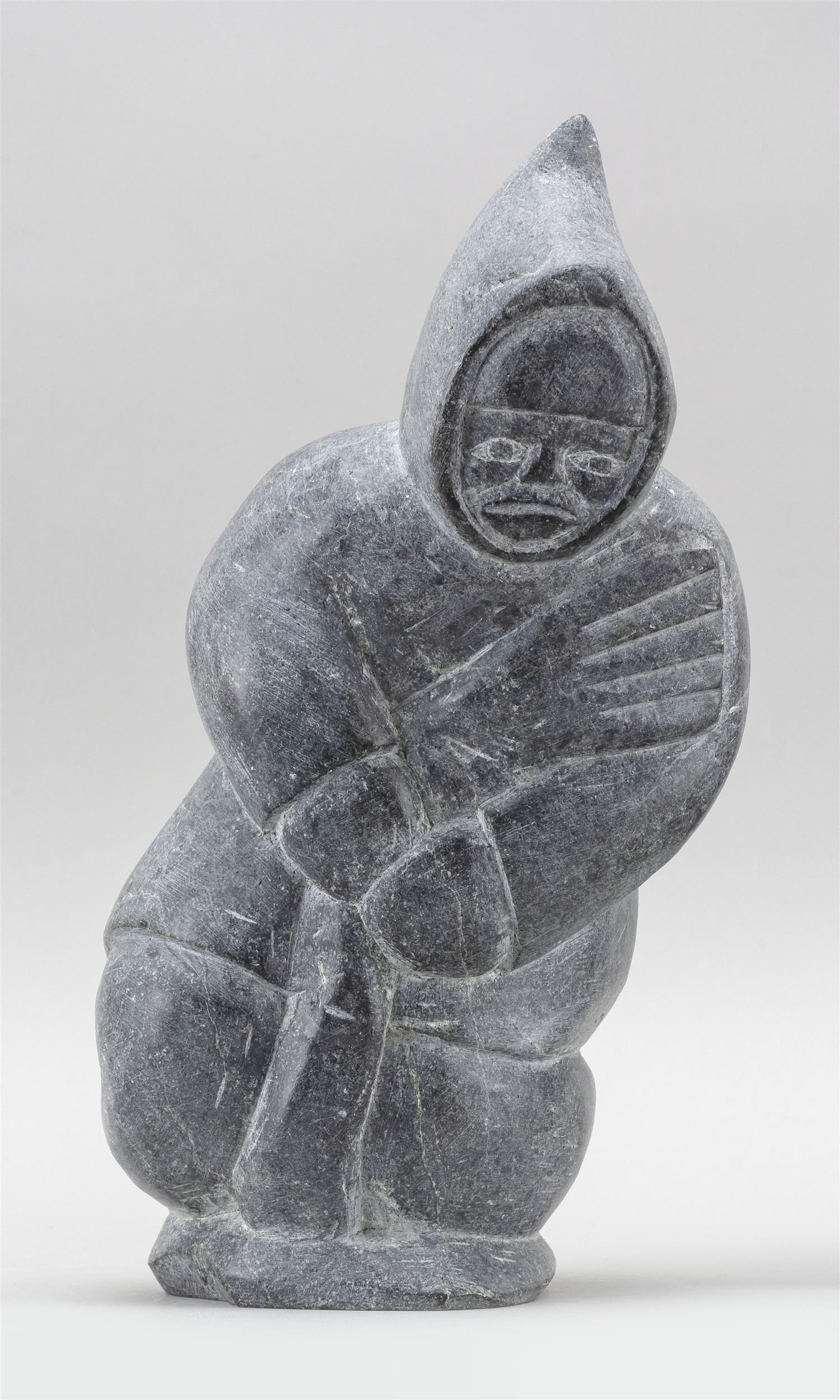 """INUIT GRAY SOAPSTONE CARVING OF AN ESKIMO WITH A SEAL Height 9"""". Proceeds to benefit Cape Symphony Orchestra."""