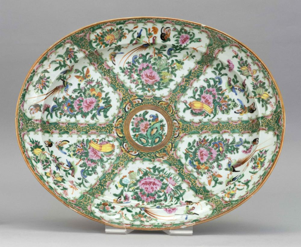 CHINESE EXPORT ROSE CANTON PORCELAIN OVAL PLATTER Alternating floral and bird panels are separated by predominantly green and gilt b...
