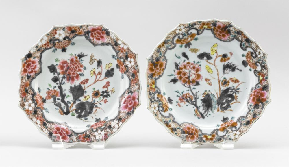 """PAIR OF CHINESE EXPORT FAMILLE ROSE PORCELAIN BARBED-EDGE PLATES With peony and prunus decoration against a rose ground. Diameters 9""""."""