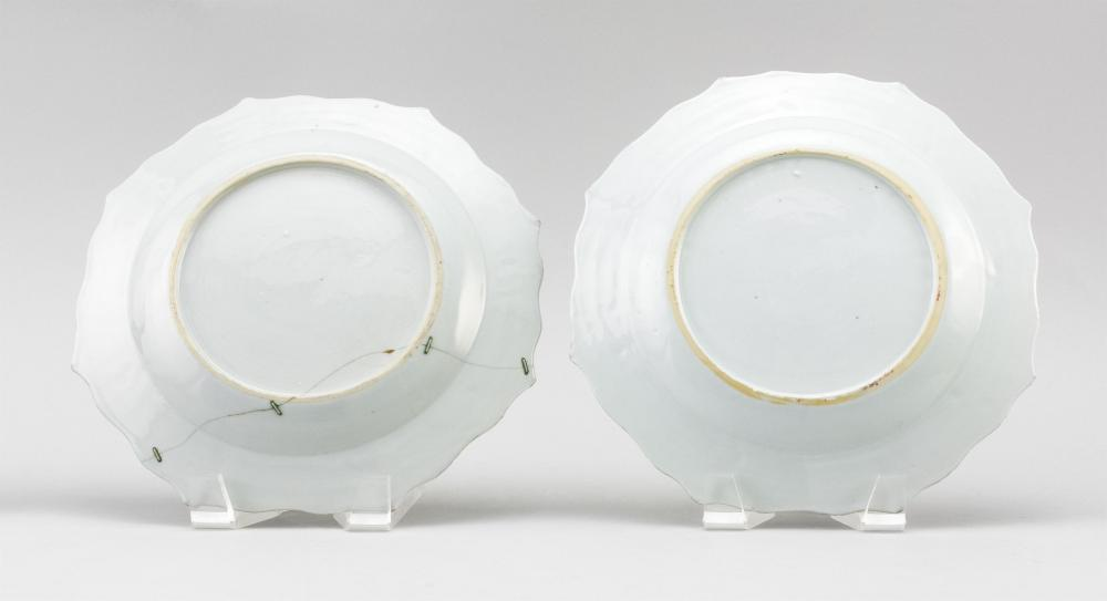 PAIR OF CHINESE EXPORT FAMILLE ROSE PORCELAIN BARBED-EDGE PLATES With peony and prunus decoration against a rose ground. Diameters 9