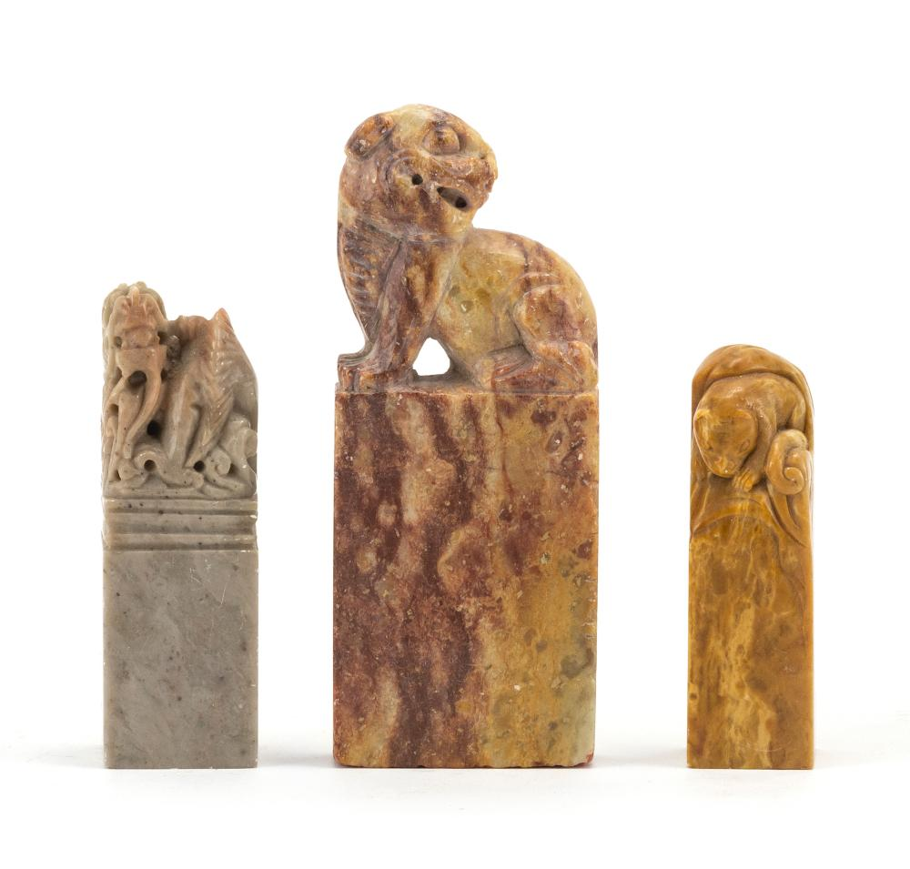 "THREE SOAPSTONE SEALS 1) With a lion-form top. Height 4.2"". 2) With a dragon-form top. Height 3"". 3) With a cat-form top and an uncu..."