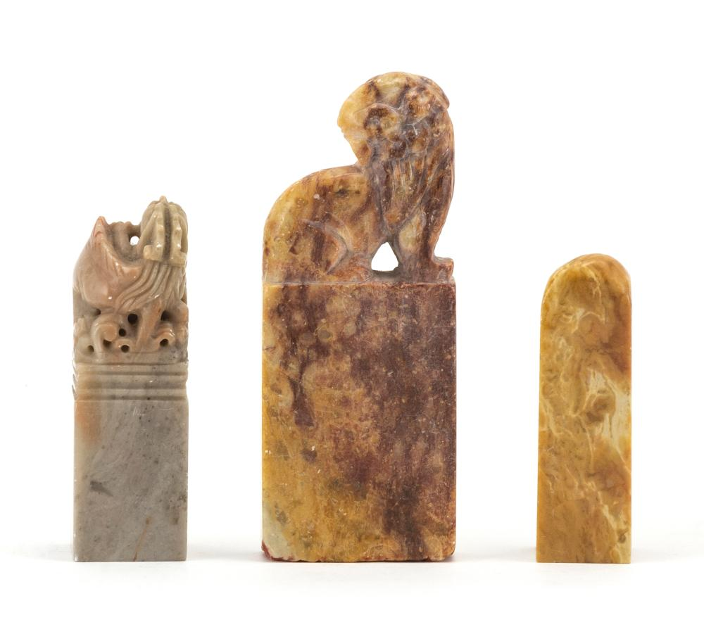 THREE SOAPSTONE SEALS 1) With a lion-form top. Height 4.2