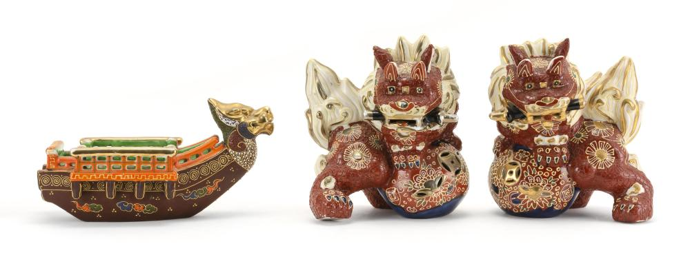 THREE PIECES OF JAPANESE MORIAGE PORCELAIN 1-2) Two foo dogs, standing on brocade balls and holding swords in their mouths. Heights...
