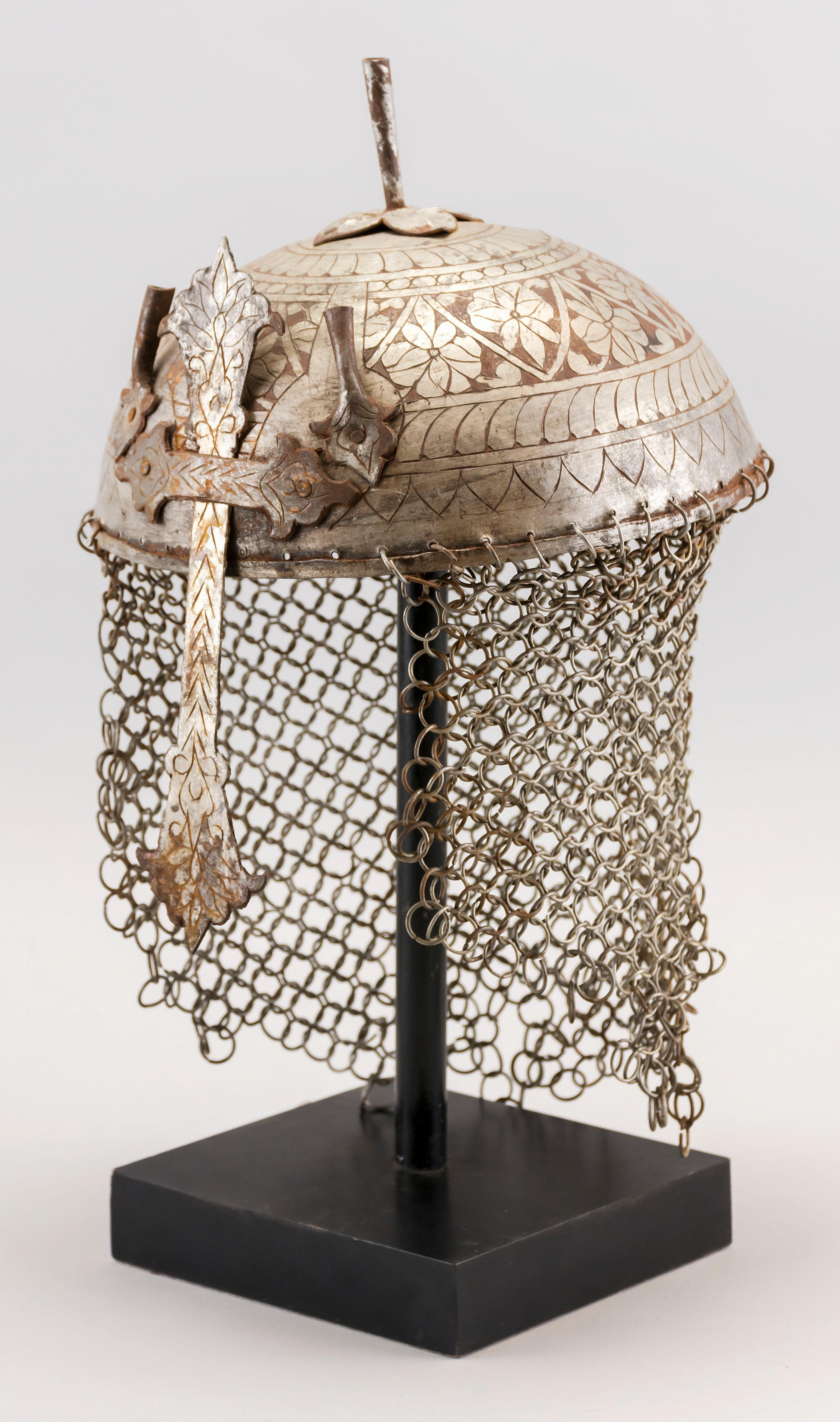 """GRAND TOUR MIDDLE EASTERN STEEL HELMET Etched with floral decoration. Height 7""""."""