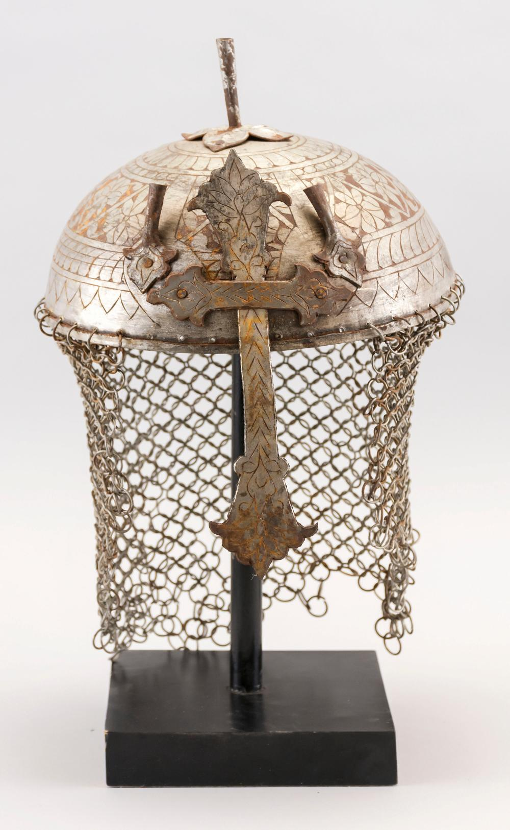 GRAND TOUR MIDDLE EASTERN STEEL HELMET Etched with floral decoration. Height 7