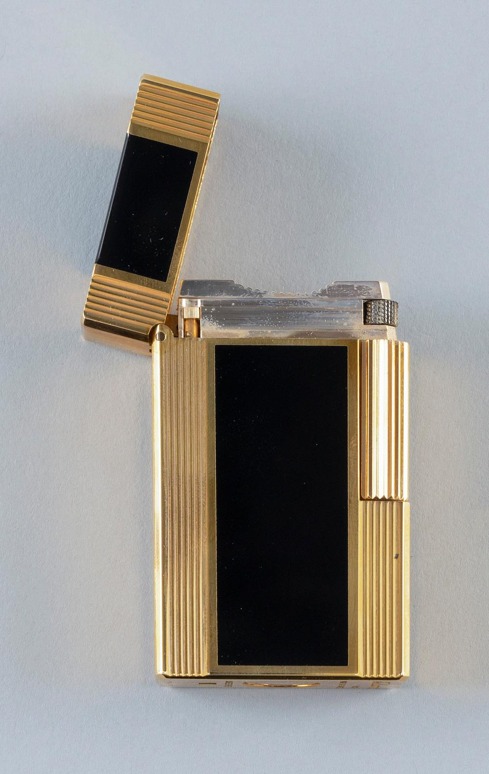 "S.T. DUPONT ""WINDSOR NOIR"" GOLD TONE AND BLACK ENAMEL LIGHTER In original case with documentation and box. Lighter length 2.25""."