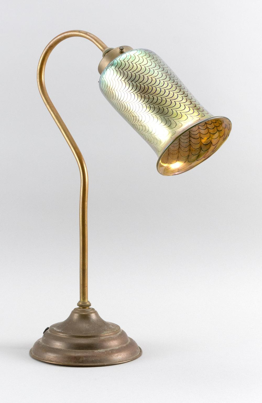 "ART GLASS AND BRASS TASK LAMP Metallic gold glass shade with pulled feather design. Simple brass base. Unmarked. Height 18.5""."