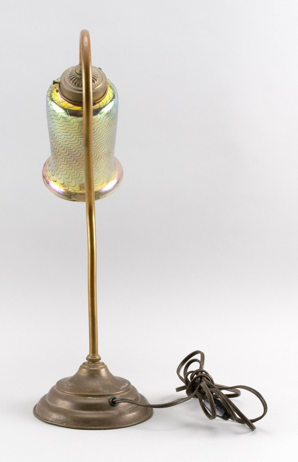 ART GLASS AND BRASS TASK LAMP Metallic gold glass shade with pulled feather design. Simple brass base. Unmarked. Height 18.5