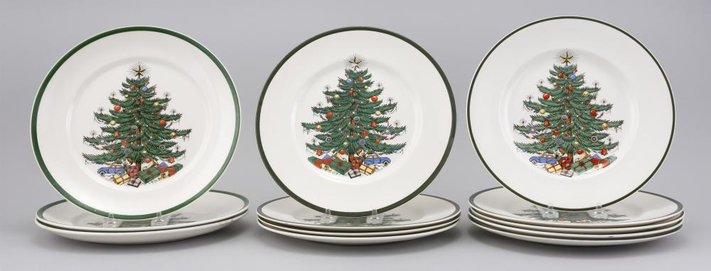 """TWELVE ASSORTED PLATES WITH SIMILAR CHRISTMAS TREE DESIGNS Makers vary. Diameters 10""""."""