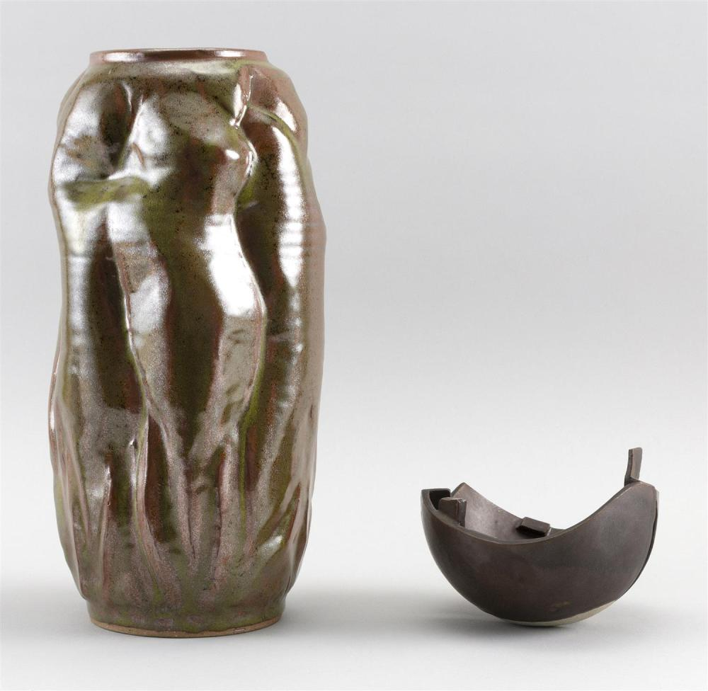 TWO STUDIO POTTERY VESSELS 1) Vase by Scargo Pottery, East Dennis, Massachusetts. Abstracted human figures in relief in a green and...