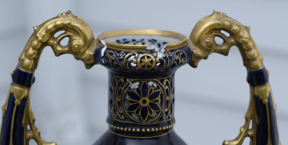 ROYAL VIENNA-STYLE HAND-PAINTED PORCELAIN COVERED URN Depicts sculpture, painting and music muses. Signed