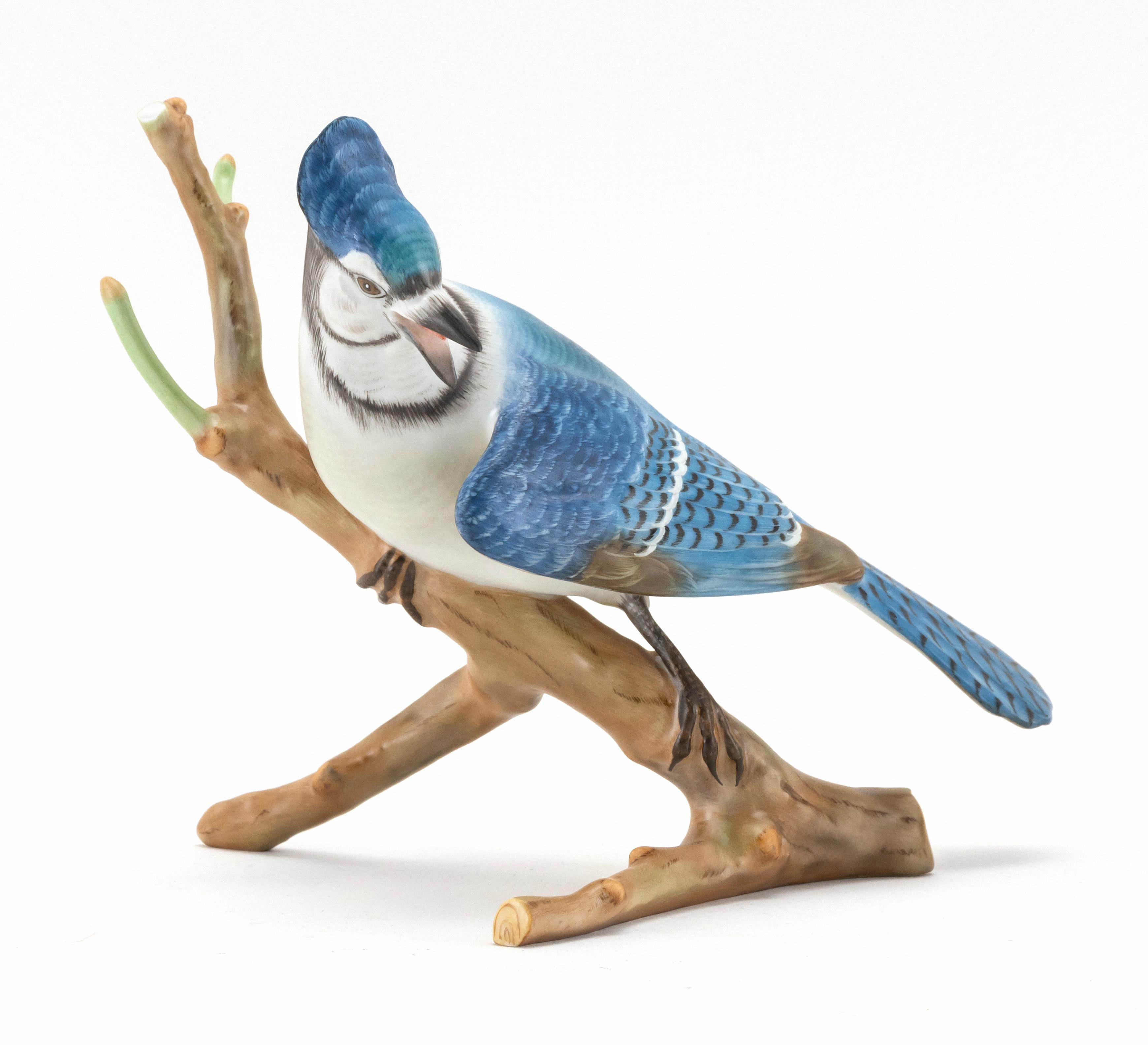"""HEREND PORCELAIN BLUEJAY Perched on a tree branch. Height 8""""."""