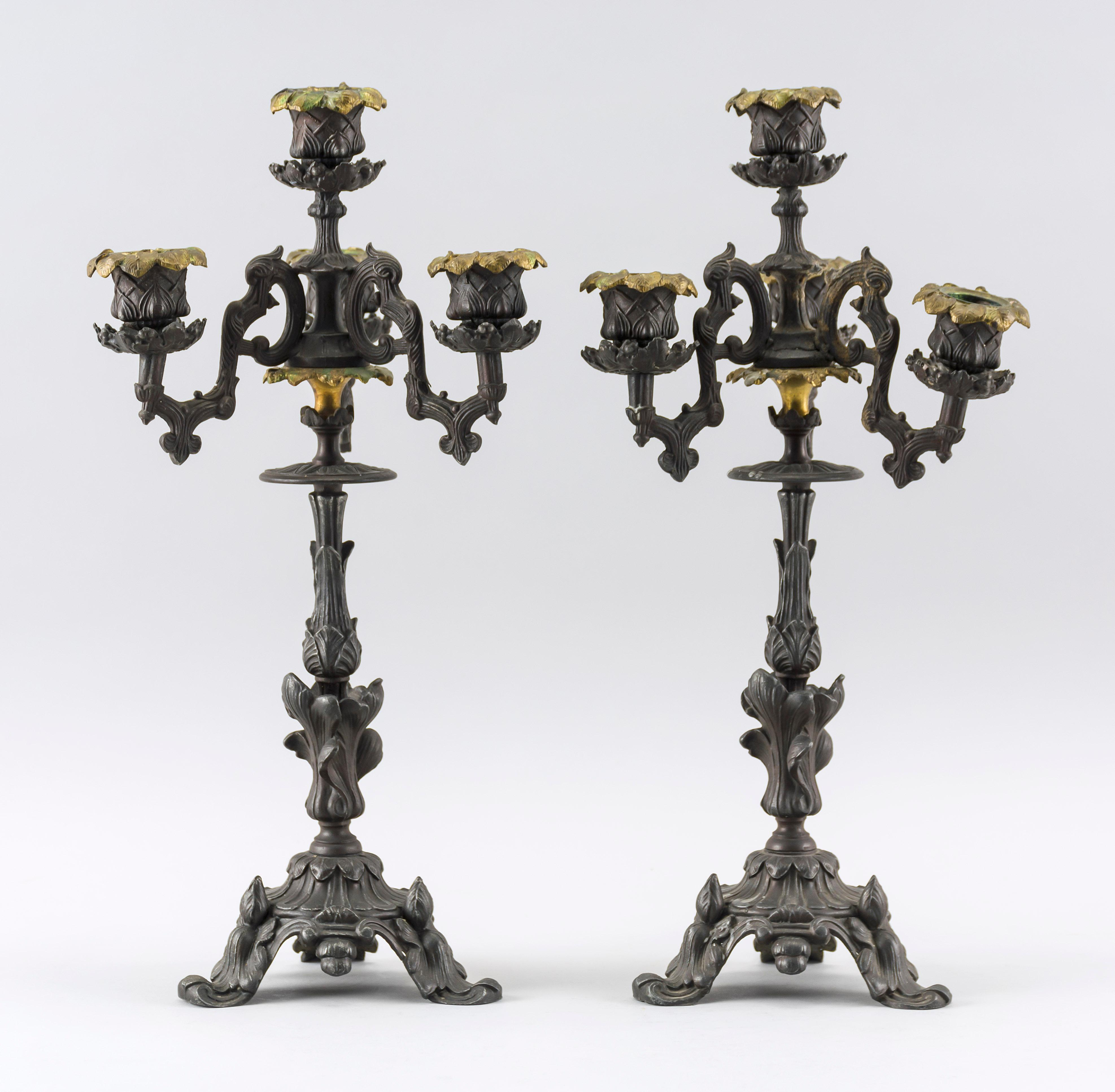 "PAIR OF CAST POT METAL FOUR-LIGHT CANDELABRA With iris designs. Marked ""DG 37"". Heights 14.5""."