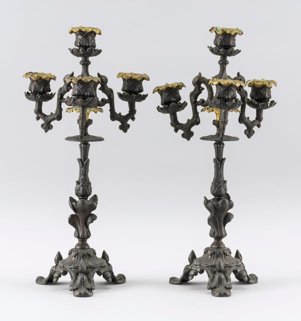 PAIR OF CAST POT METAL FOUR-LIGHT CANDELABRA With iris designs. Marked