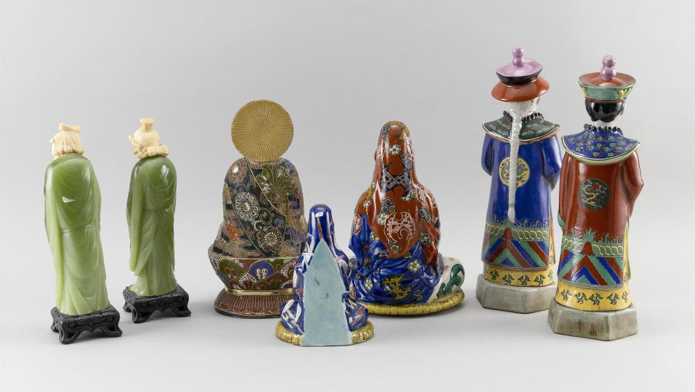 SEVEN JAPANESE AND CHINESE FIGURES 1-3) Three porcelain Guanyin/Kwannon figures. Heights from 7