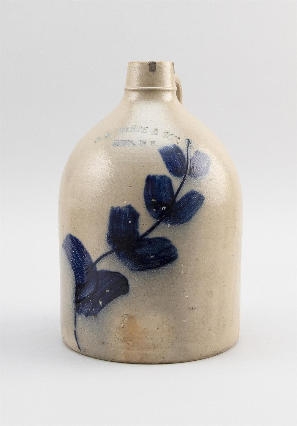"""STONEWARE CROCK Incisced mark for """"A.A. White & Son Utica N.Y."""" above bold cobalt blue decoration. Height 11""""."""
