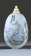 PAINTED PORCELAIN SNUFF BOTTLE In egg form. Decorated with a scholar on one face; bird and tree branch on reverse. Attributed to the...