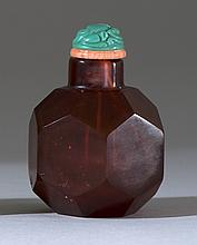 FACETED RUBY GLASS SNUFF BOTTLE In modified ovoid form. Height 2