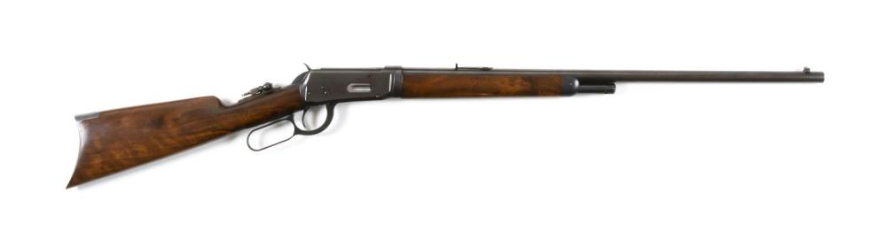 RARE WINCHESTER MODEL 1894 LEVER ACTION RIFLE .25-.35 cal., Serial #198703. Exceptionally figured wood stock. Blued finish. Very min...