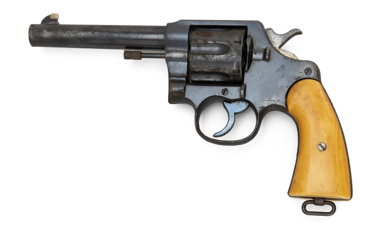 "* COLT MODEL 1917 REVOLVER .45 cal., Serial #[?]49039. Bone grips. Blued finish. Length of barrel 5.5"". Overall length 10.5"". This g..."