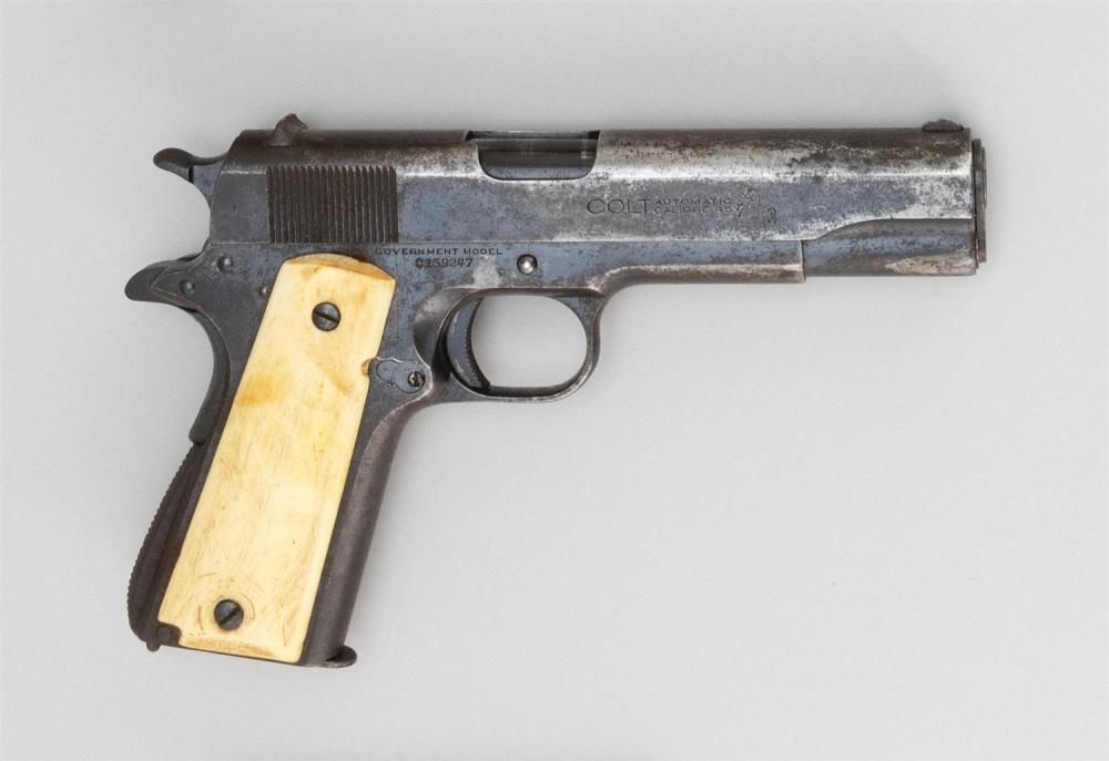 * COLT MODEL 1911 CIVILIAN SEMI-AUTOMATIC PISTOL .45 cal., Serial #C159247. Bone grips. Blued finish. Length of barrel 5