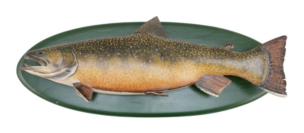 "MIKE BORRETT CARVED AND PAINTED WOODEN BROOK TROUT Mounted on a green-painted oval backboard. Signed and dated on reverse ""Mike Borr..."