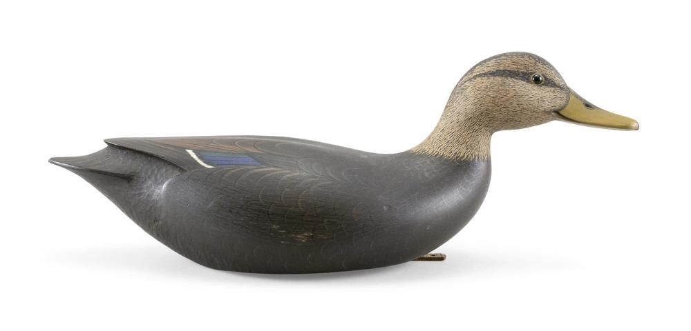 "MARTY COLLINS BLACK DUCK DECOY In swimming form. Glass eyes. Chip-carved tail. Brass plaque on underside stamped ""Martin D. Collins""..."