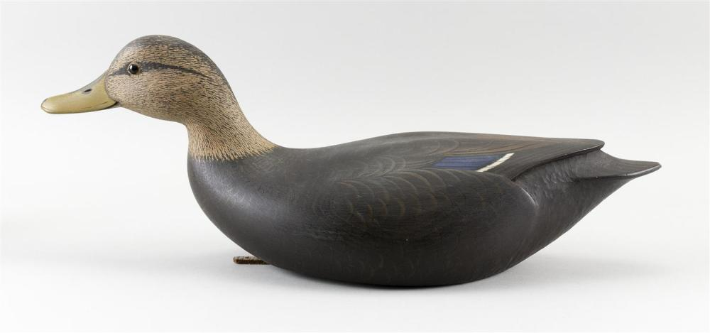 MARTY COLLINS BLACK DUCK DECOY In swimming form. Glass eyes. Chip-carved tail. Brass plaque on underside stamped