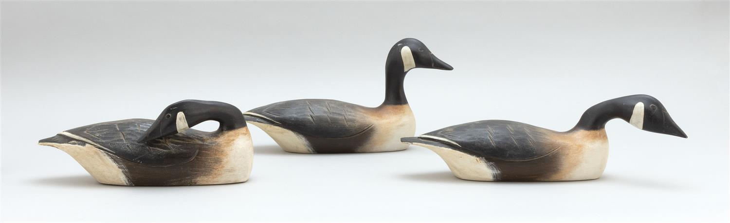 "THREE HANK WALKER QUARTER-SIZE CANADA GEESE Each with different head positions. Lengths from 11"" to 15""."