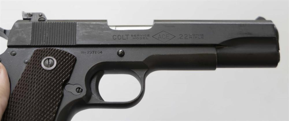 * COLT ACE SERVICE MODEL SEMI-AUTOMATIC PISTOL .22 cal., Serial #297104. Floating chamber. Parkerized finish. Hard plastic grips. Mi...