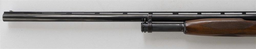 * WINCHESTER MODEL 12 TRAP SLIDE-ACTION SHOTGUN 12-ga., Serial #1968336. Choked at full. Vent ribbed barrel. Blued finish. Minor wea...