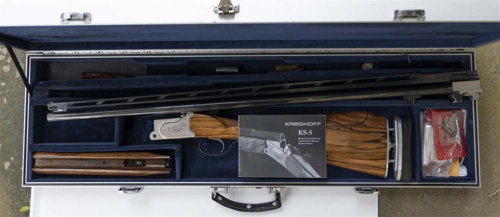 * CASED KRIEGHOFF SINGLE-BARREL TRAP SHOOTING SHOTGUN 12-ga., Serial #16736. Vent ribbed and ported barrel. Moderate wear. Length of...