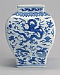 BLUE AND WHITE PORCELAIN VASE In modified rectangular form with phoenix and dragon design. Six-character Ming mark on base. Height 8...