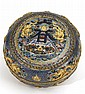 IMPORTANT CLOISONNÉ ENAMEL BOX In circular form. Domed cover decorated with relief five-claw dragons, calligraphy, and treasure vess...