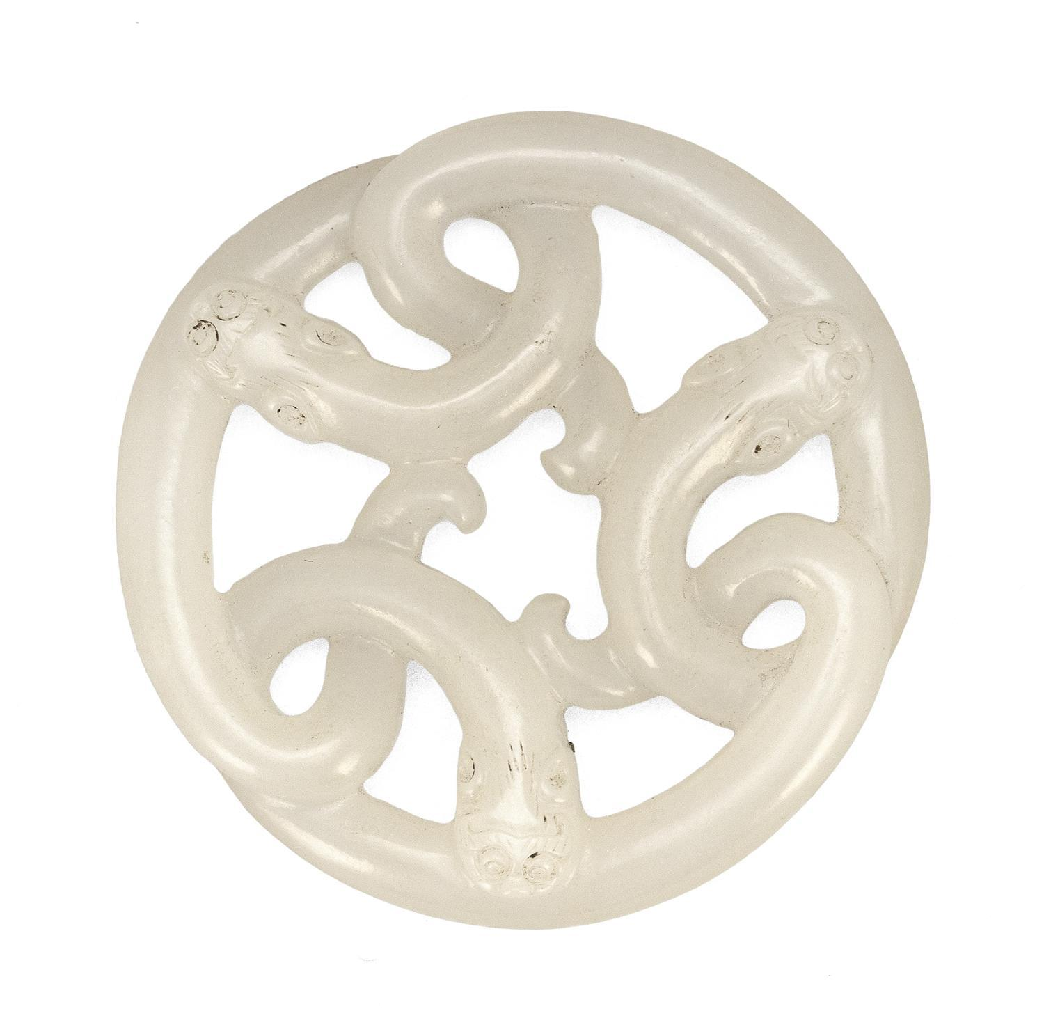 """PURE WHITE JADE PENDANT In the form of three entwined sinuous chilong dragons (baby dragons). Diameter 2"""". This dragon design origin..."""