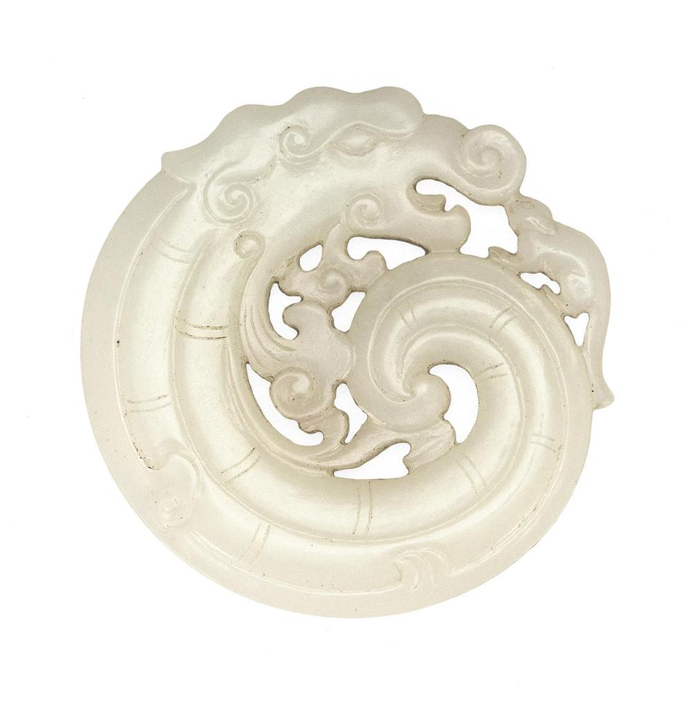 SUPERB FLAWLESS WHITE JADE OPENWORK BI PENDANT In the form of a sinuously curled archaic dragon holding ruyi fungus and with a small...