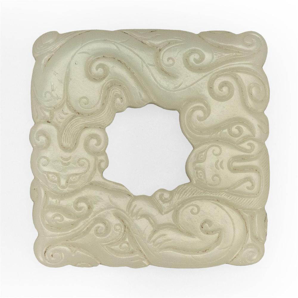 FINE WHITE JADE BI PENDANT Square, with delicate carving of archaic dragons on both sides. Dragons with strong sinuous bodies in an...