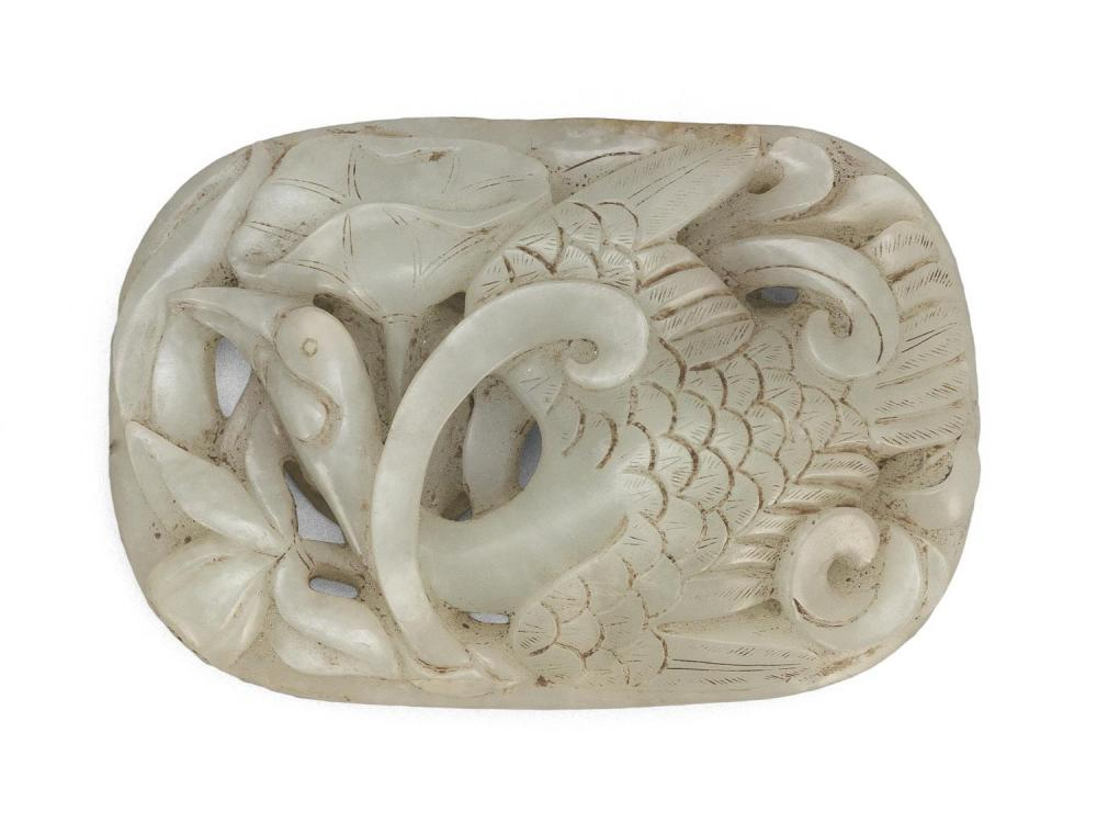 MUTTONFAT JADE BELT BUCKLE Convex oval, with a multi-layered design of a goose in flight, swooping between long stems of lotus flowe...