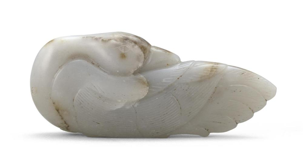 GRAY AND RUSSET JADE GOOSE-FORM PENDANT With its head turned back, tucked into a sleeping position. Folded wings with five delicatel...