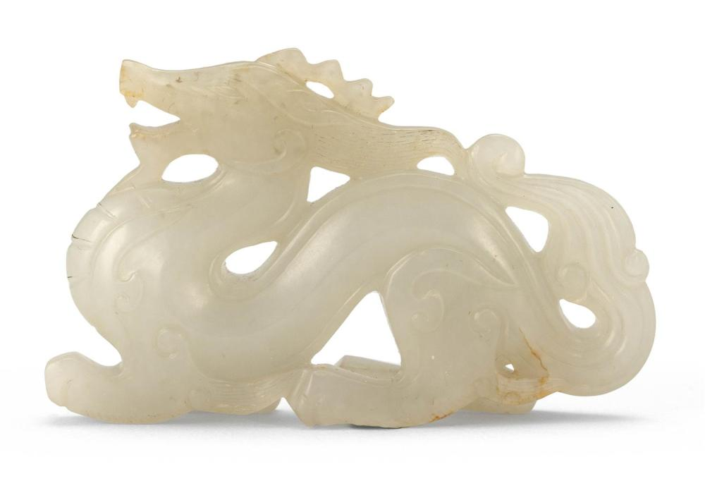 WHITE JADE CARVING OF A RAMPANT DRAGON With raised head and tail, and a layered body decorated with archaic scrolls. Formed from a n...