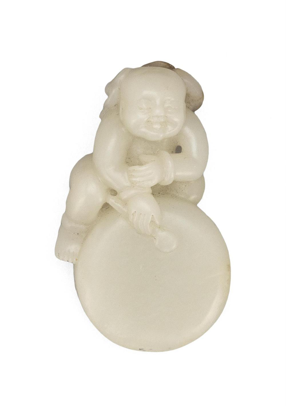 VERY RARE WHITE JADE CARVING OF THE IMMORTAL LIU HAI Resting on and beating a large drum, which calls to the immortal three-legged t...