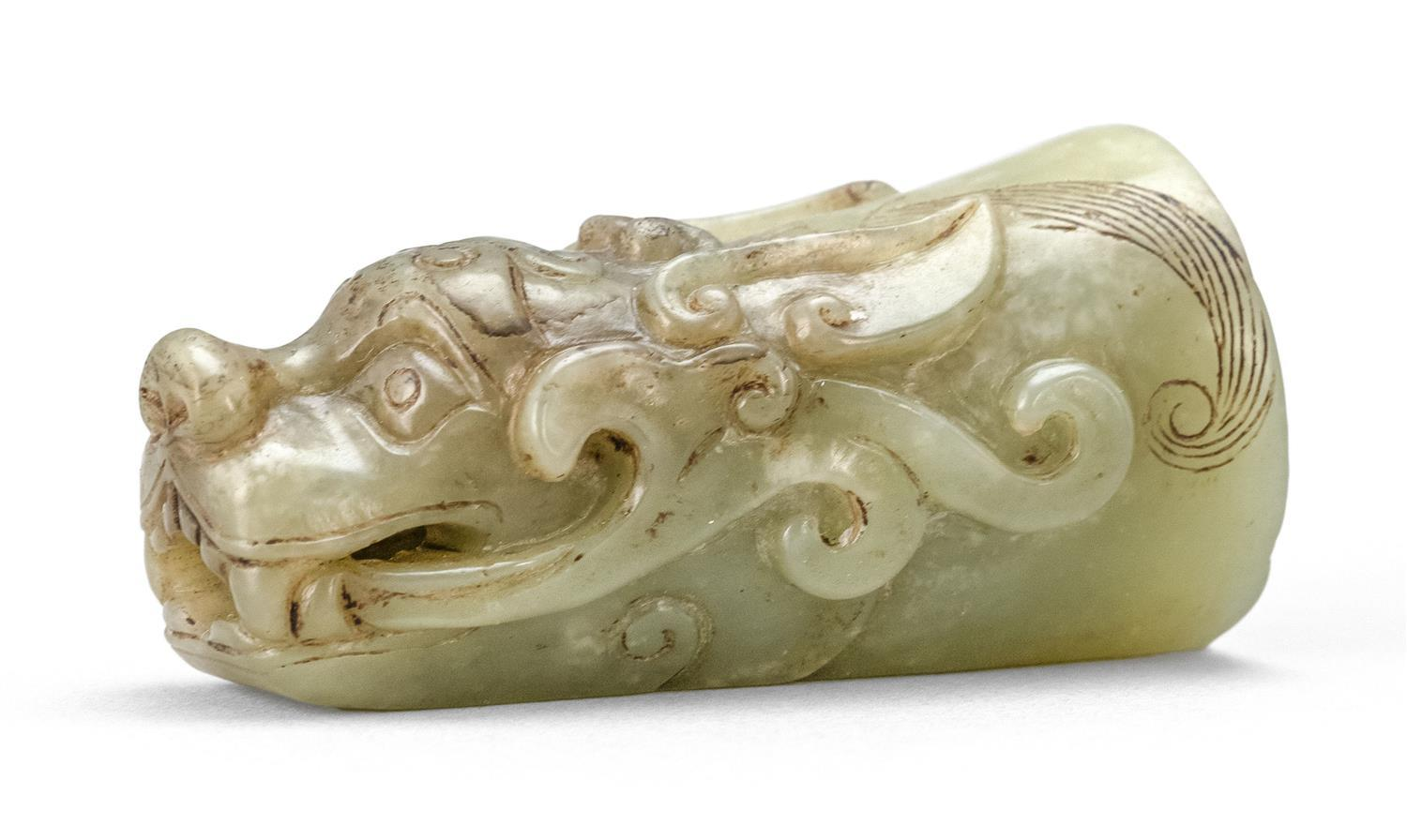 EXTREMELY RARE YELLOW JADE PIPE MOUTH PIECE In the form of a ferocious dragon's head, with vaporous clouds issuing from each side of..
